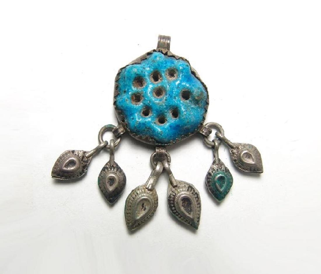 Egyptian blue-glazed rosette amulet set into a brooch