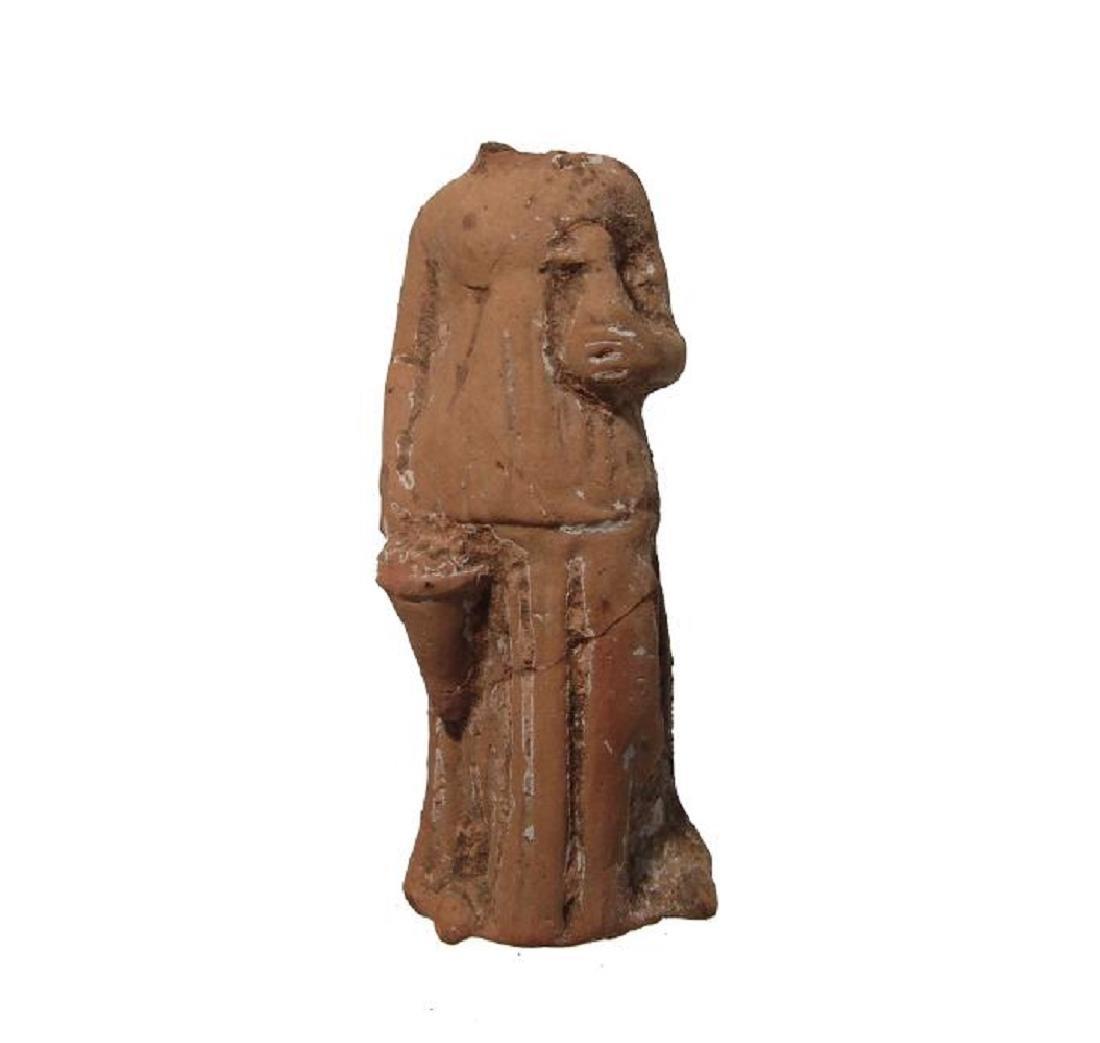 A Greek terracotta female body