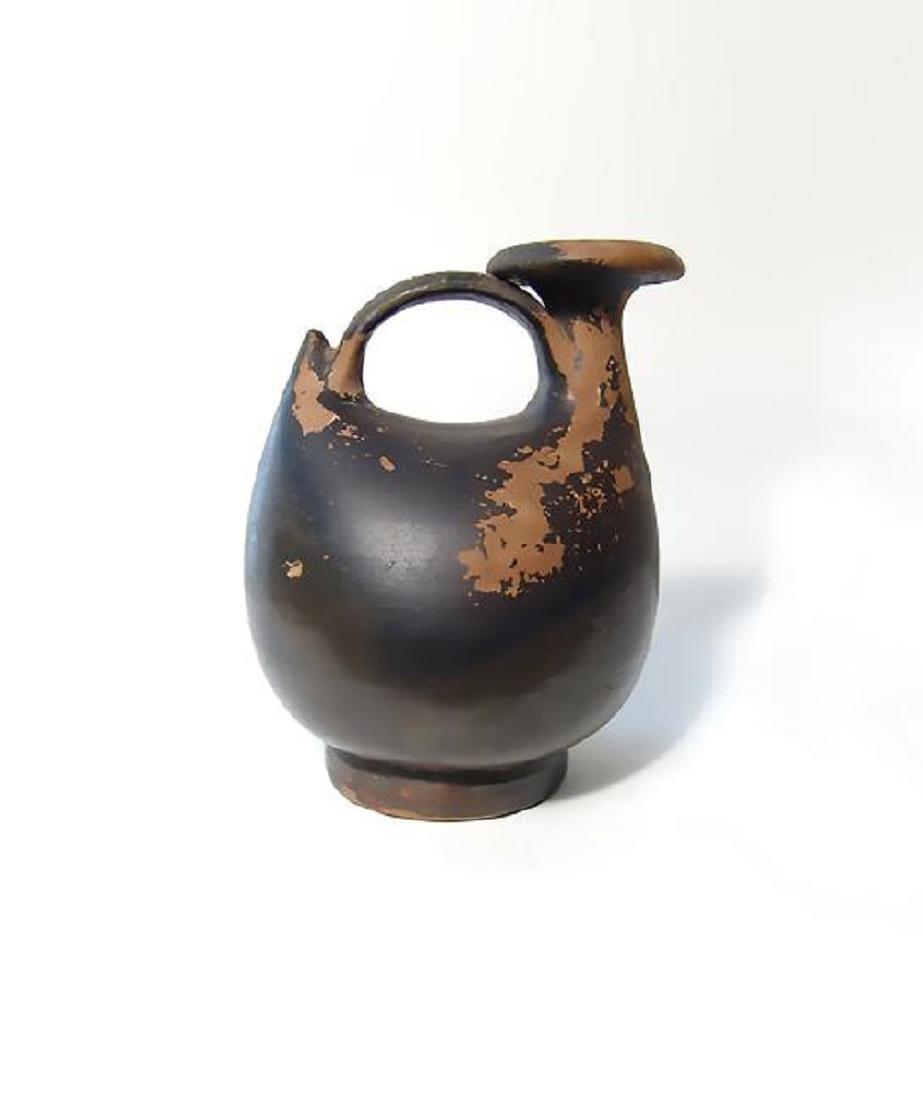 A Greek black-ware 'duck-shaped askos'