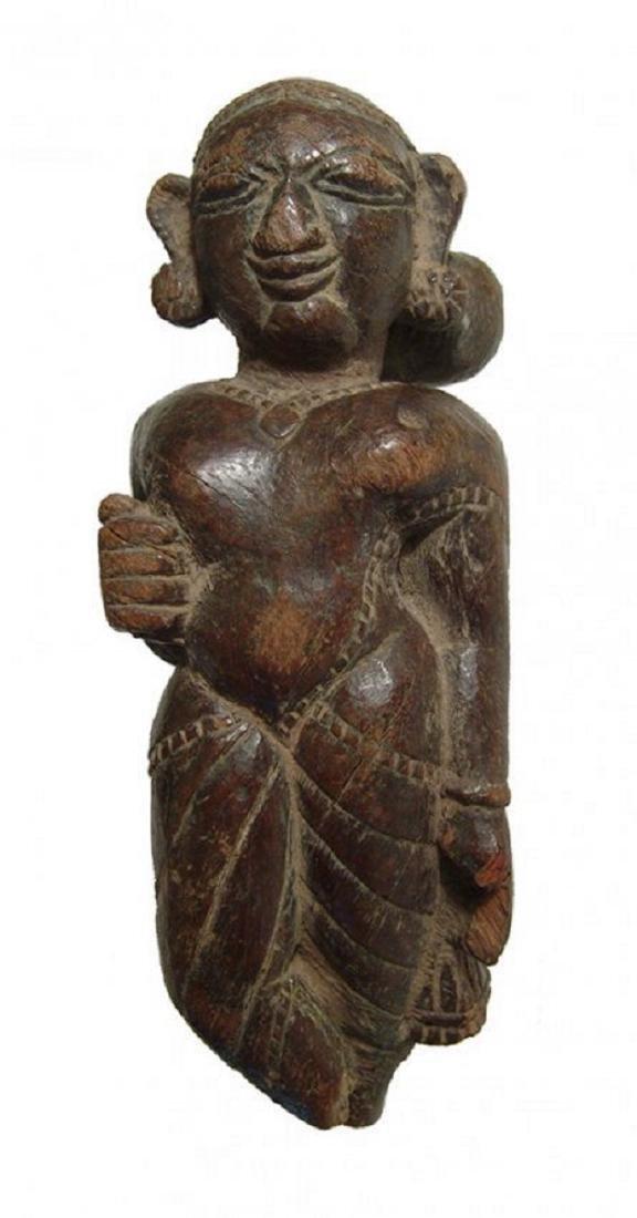 An Indian wooden figure of a Yaksha