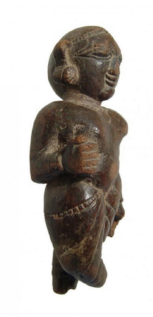 An Indian wooden figure of a Yaksha - 2