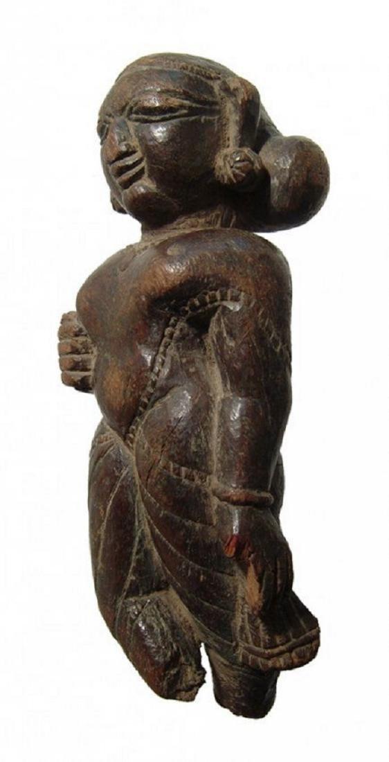 An Indian wooden figure of a Yaksha - 4
