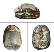 An Egyptian steatite scarab, 2nd Intermediate Period