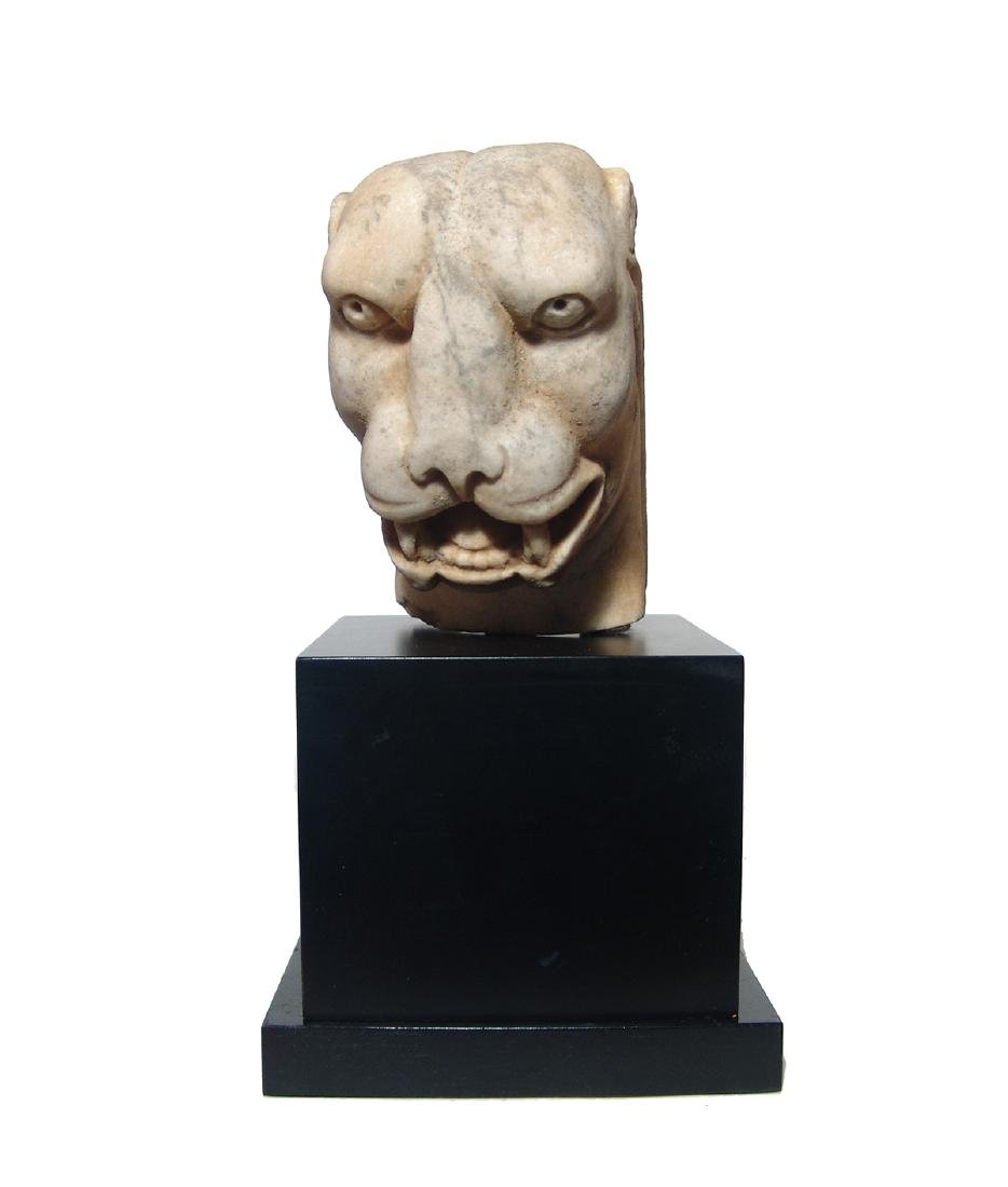 A stunning Roman marble head of a panther