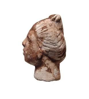 A Roman stucco head of a woman