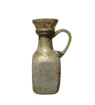 A nice little Roman green glass bottle