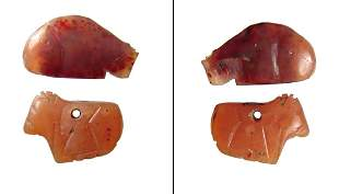 Pair of Egyptian carnelian amulets, Late New Kingdom