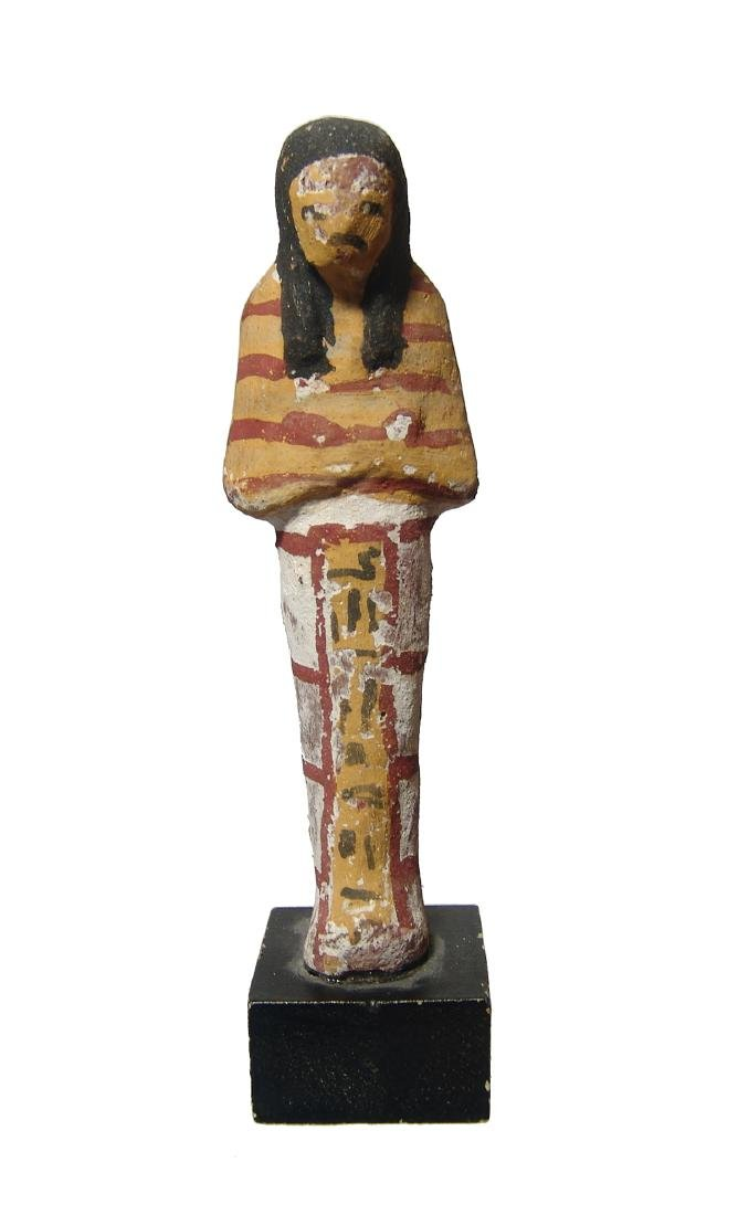 An Egyptian terracotta painted ushabti, New Kingdom