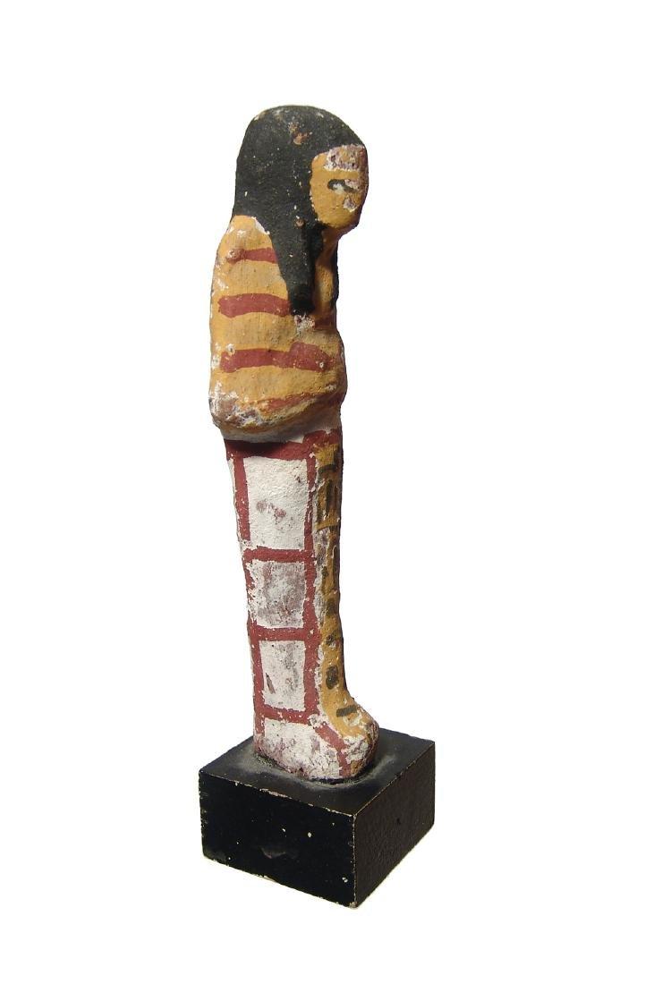 An Egyptian terracotta painted ushabti, New Kingdom - 2