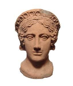 A gorgeous Etruscan terracotta female votive head