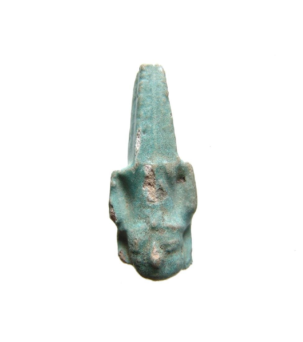 Egyptian faience head from a large amulet of Nefertum
