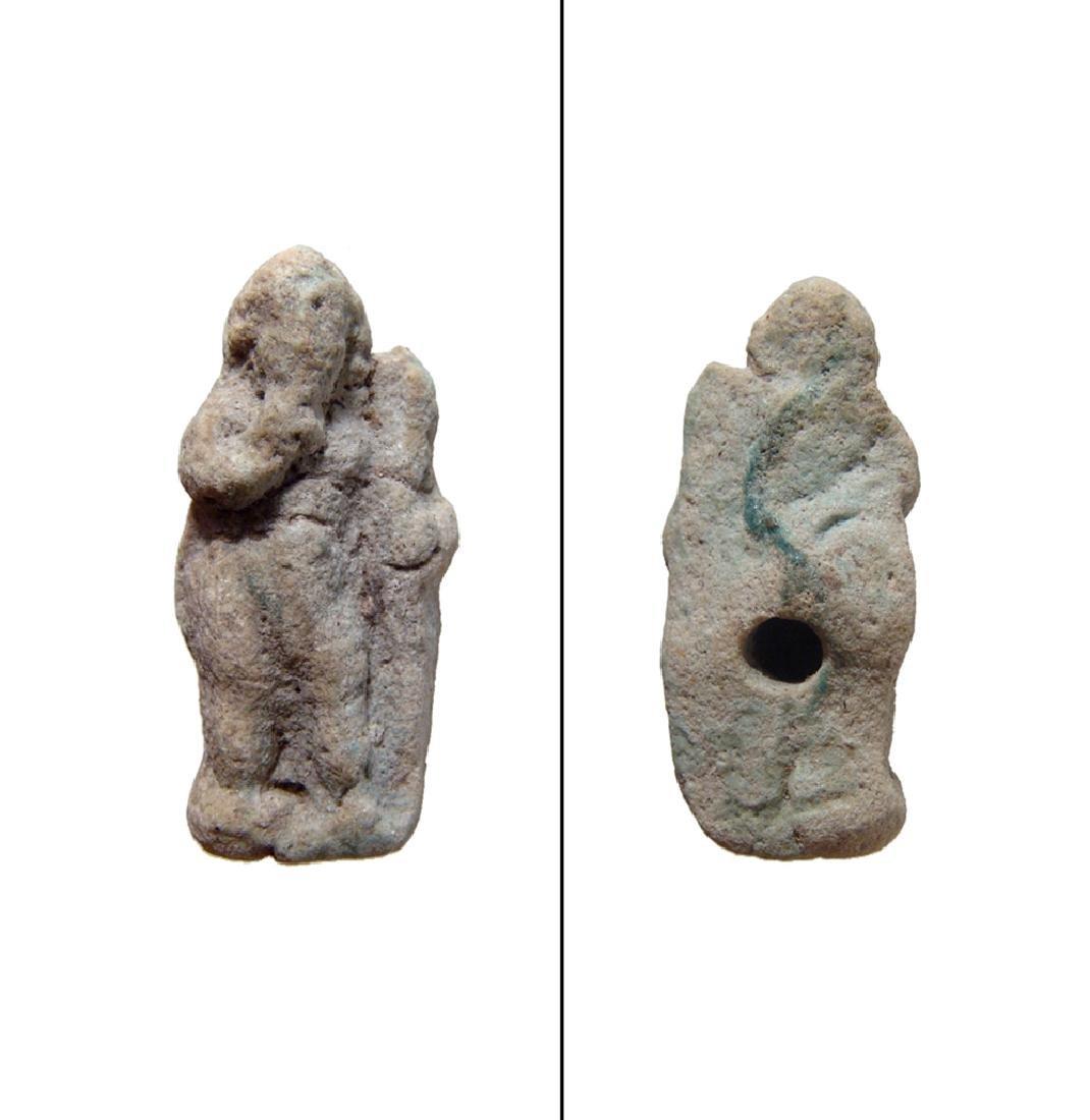 An Egyptian faience amulet of Harpokrates, Roman
