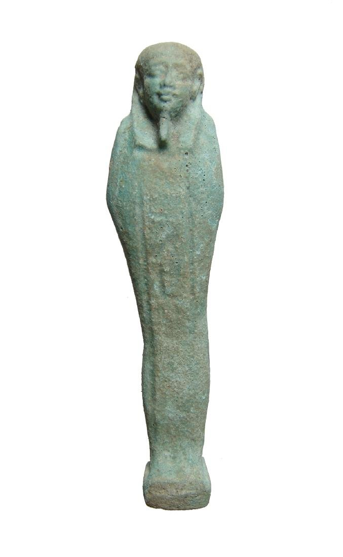 An Egyptian pale green faience ushabti