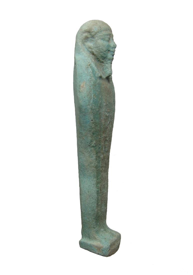 An Egyptian pale green faience ushabti - 2