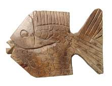 A carved stone fish in ancient Egyptian style