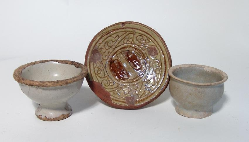 A trio of glazed Islamic - Asian pottery items