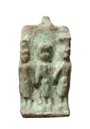 An Egyptian faience plaque of the Triad