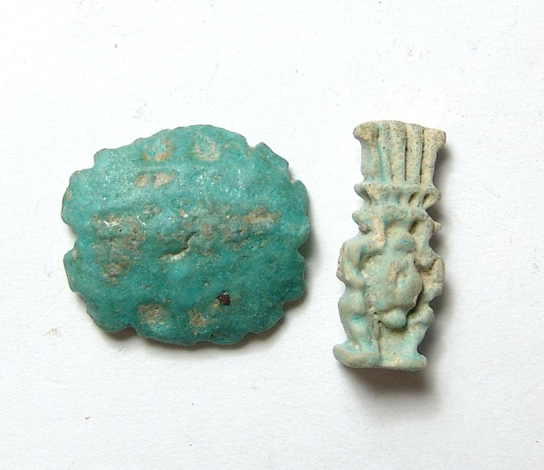A pair of Egyptian faience amulets, Late Period