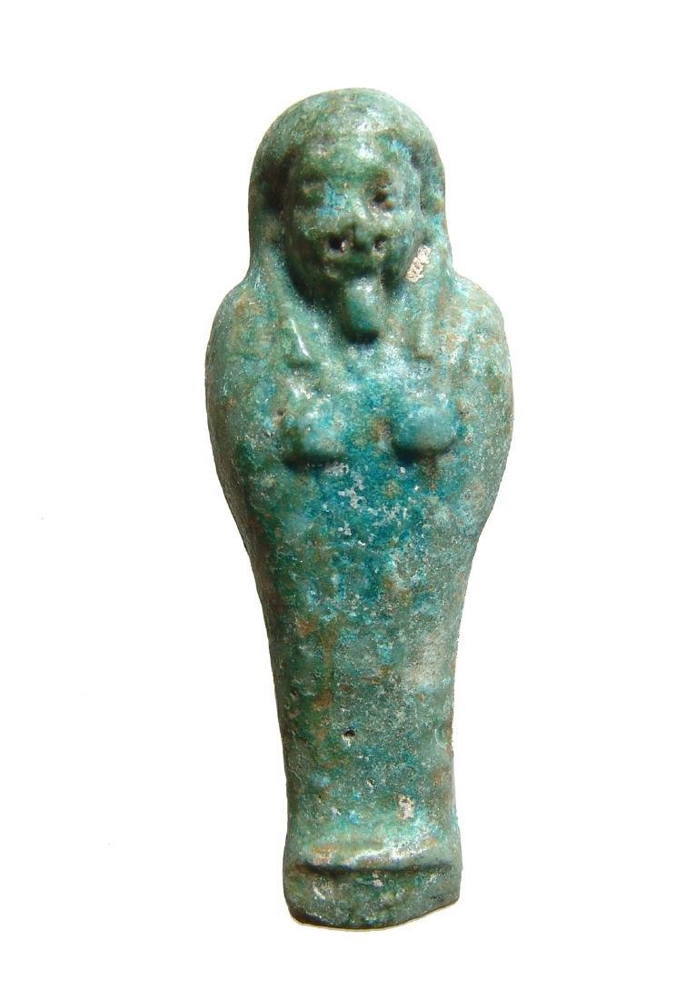 An Egyptian blue-green faience ushabti