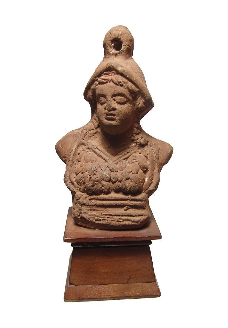 A Roman terracotta bust of Minerva, Egypt