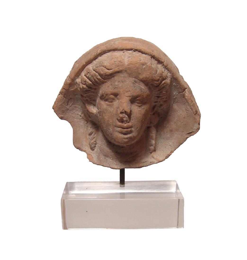 A beautiful Etruscan terracotta votive head