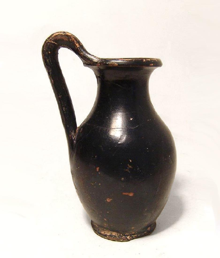 A Greek black glazed olpe