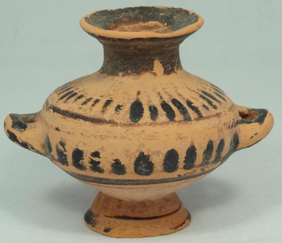 A small Greek terracotta footed hydria