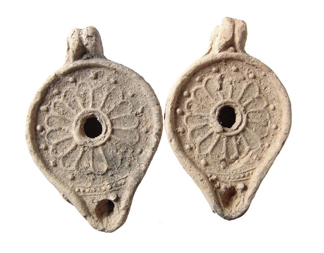 A pair of 2 matching Roman ceramic lamps, Levant