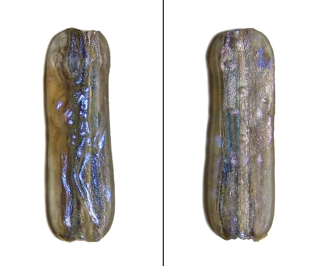 A rare Roman glass bead with Apollo