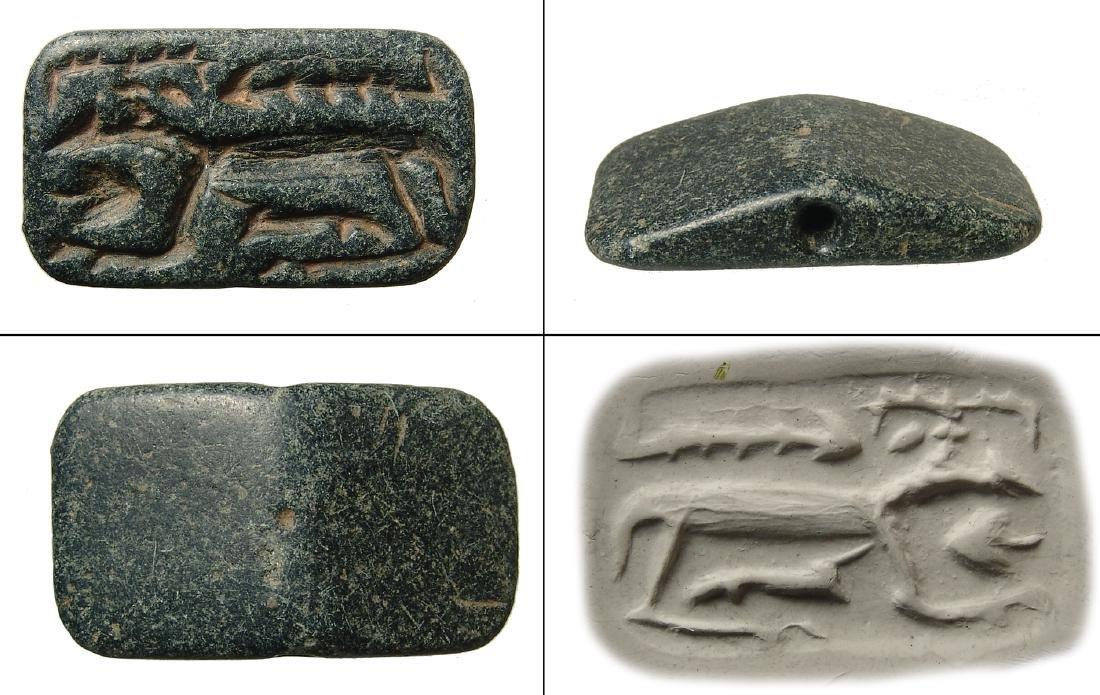 A large Near Eastern black steatite gabled stamp seal