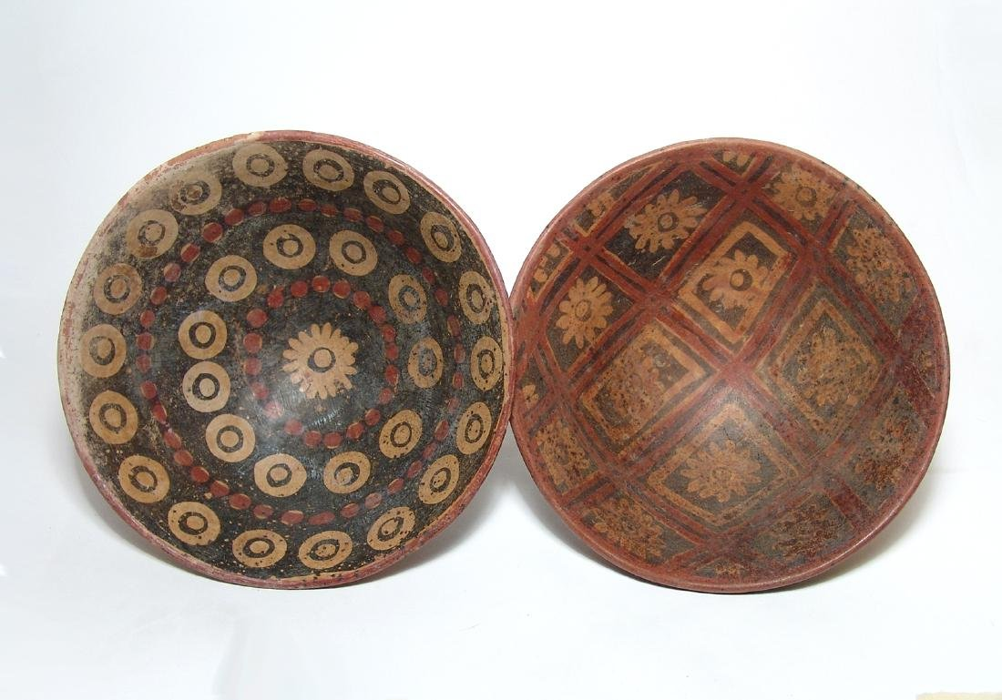A pair of colorful Narino pedestal bowls, Colombia