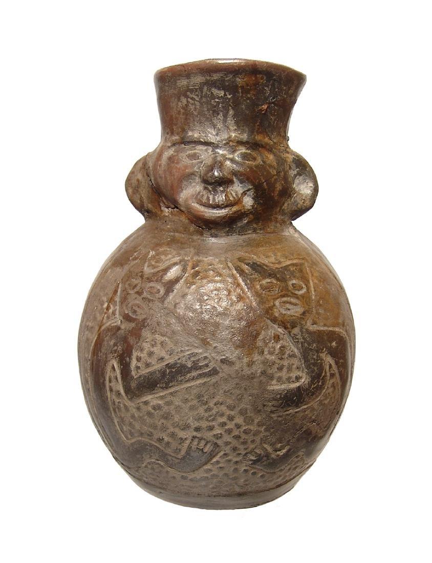 A Chimu black-ware figural vessel