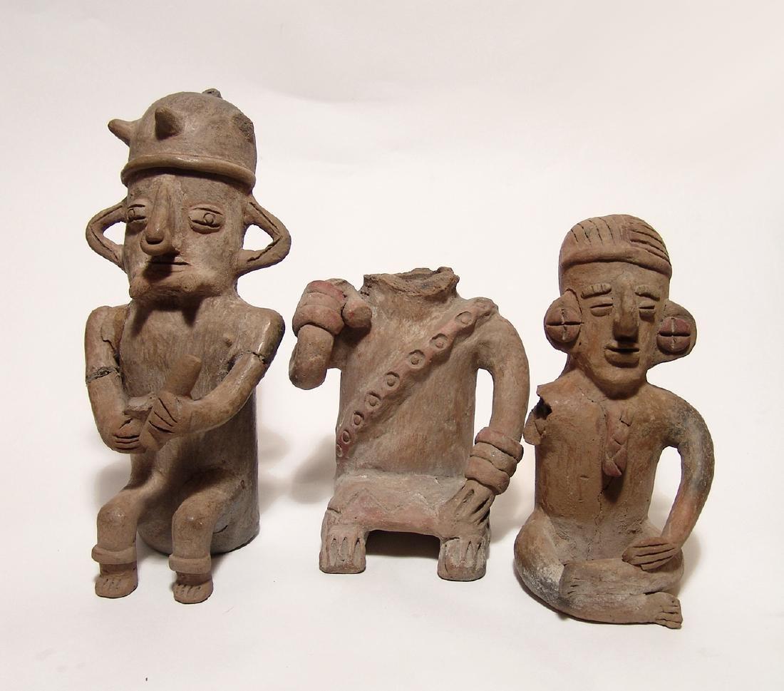 A group of three Large Manteno ceramic figurines