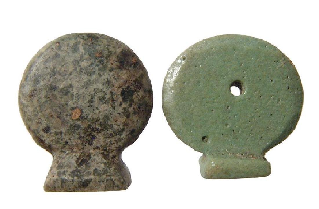 A pair of Egyptian solar disk amulets