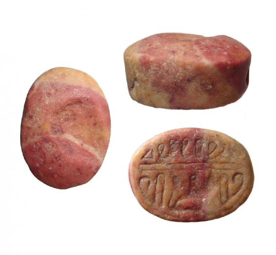 An Egyptian red-yellow marble scaraboid