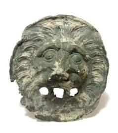 An attractive bronze facing lion head applique