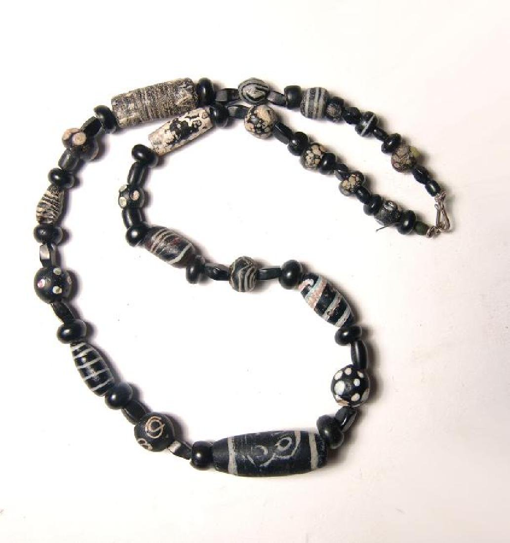 Necklace w/ assorted ancient black & white glass beads