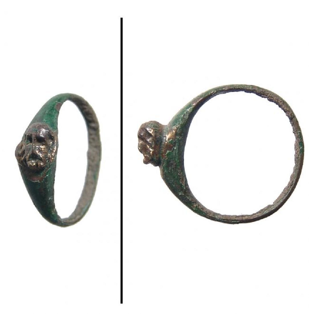 Roman bronze ring with bearded head in relief