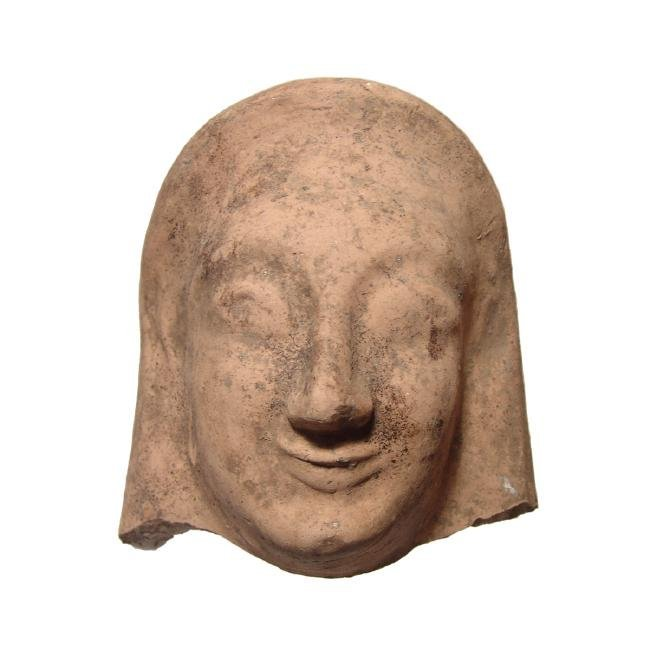 A Greek terracotta female protome with archaic features