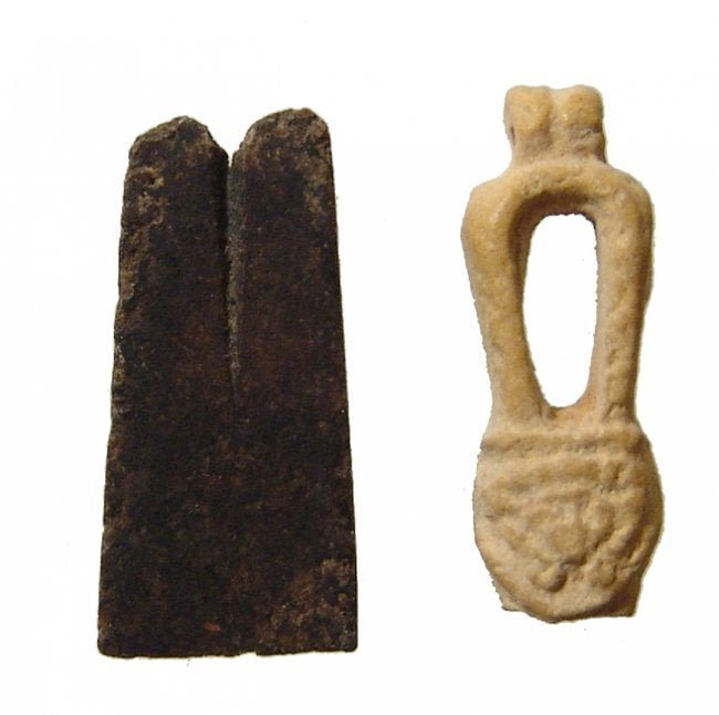A pair of stone and faience Egyptian amulets