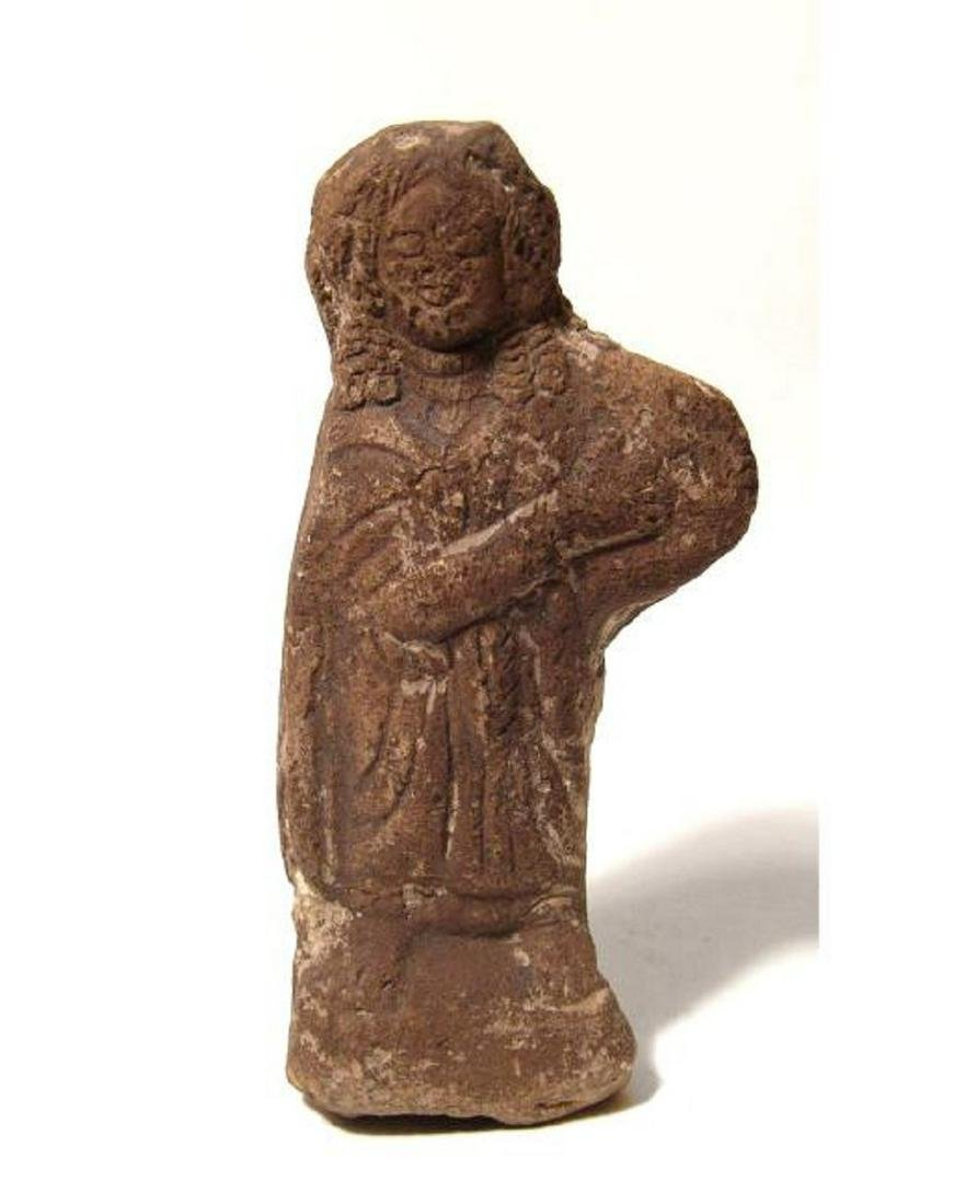 A Roman terracotta figure of a robed woman