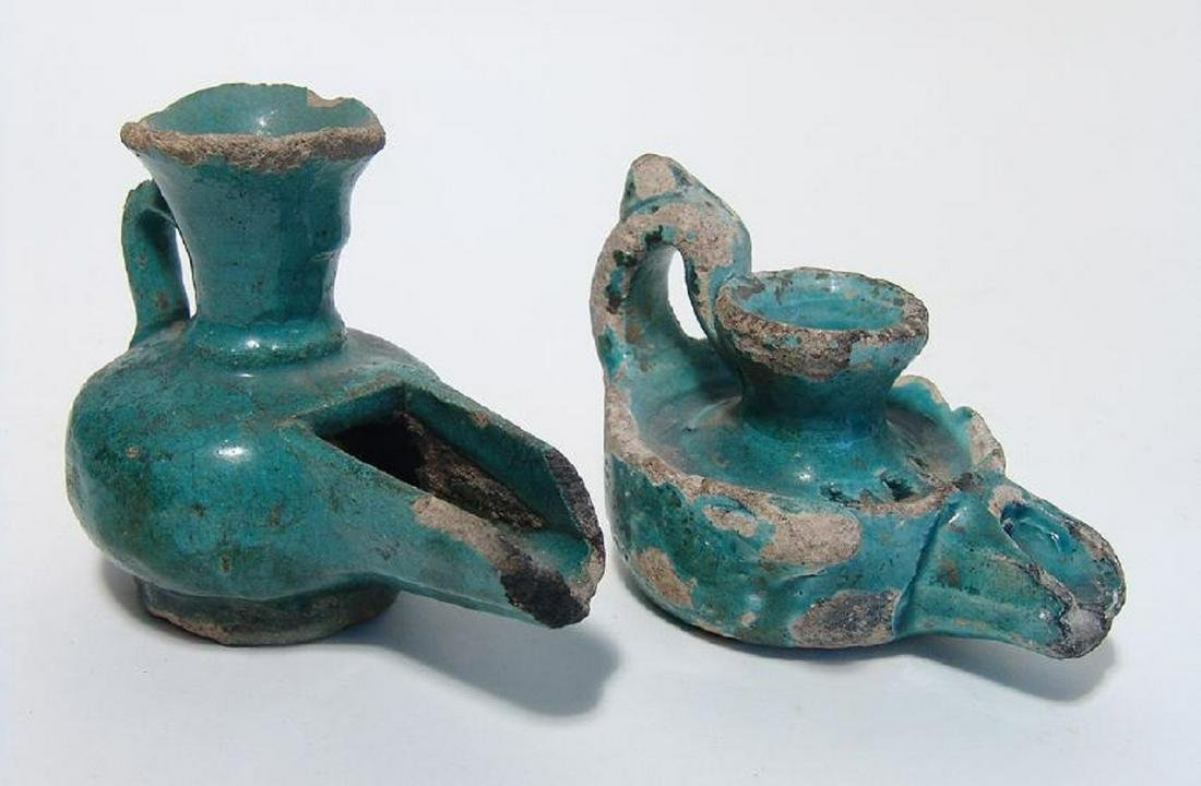A pair of Persian/Islamic glazed lamps