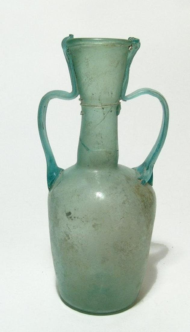 A large Roman glass two-handled bottle