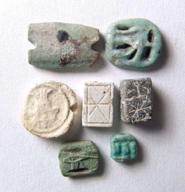 A group of 7 Egyptian faience plaques and beads