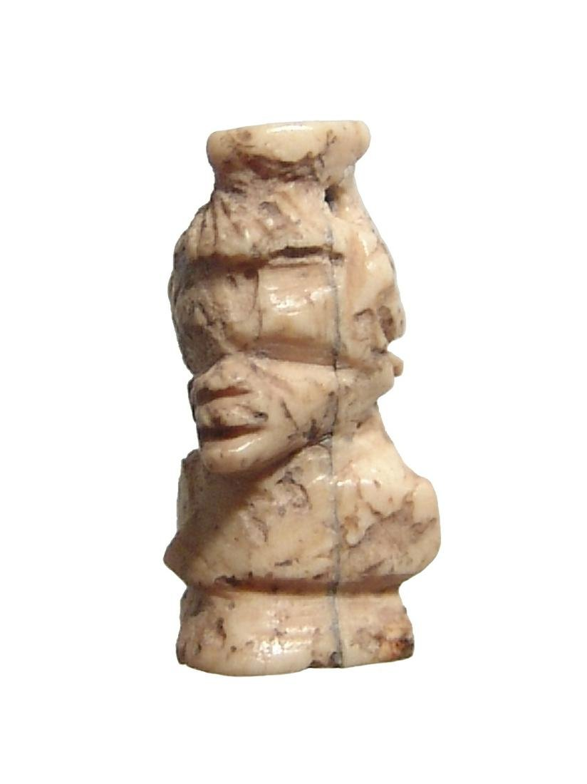 Romano-Egyptian bone amulet in form of a Nubian bust