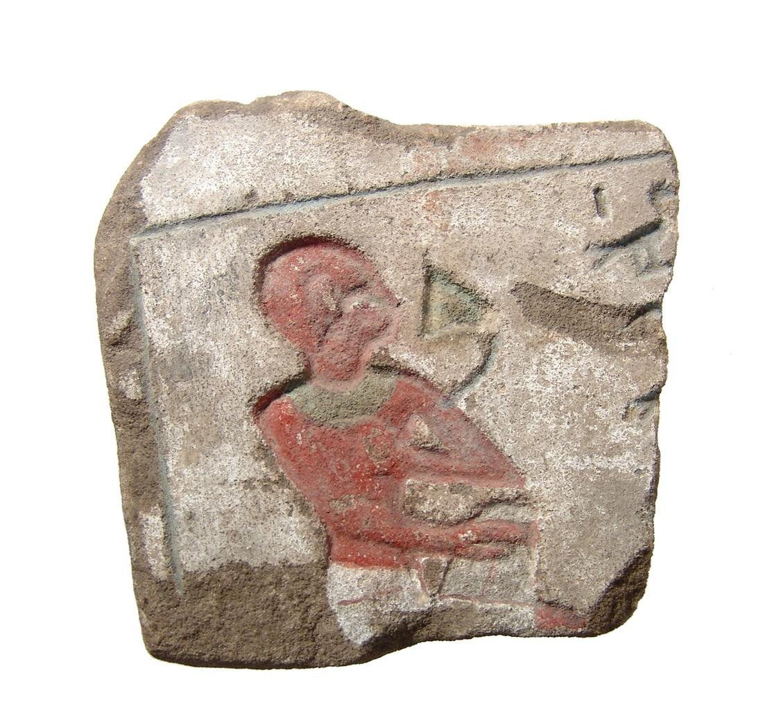 Egyptian sandstone relief fragment with pigment