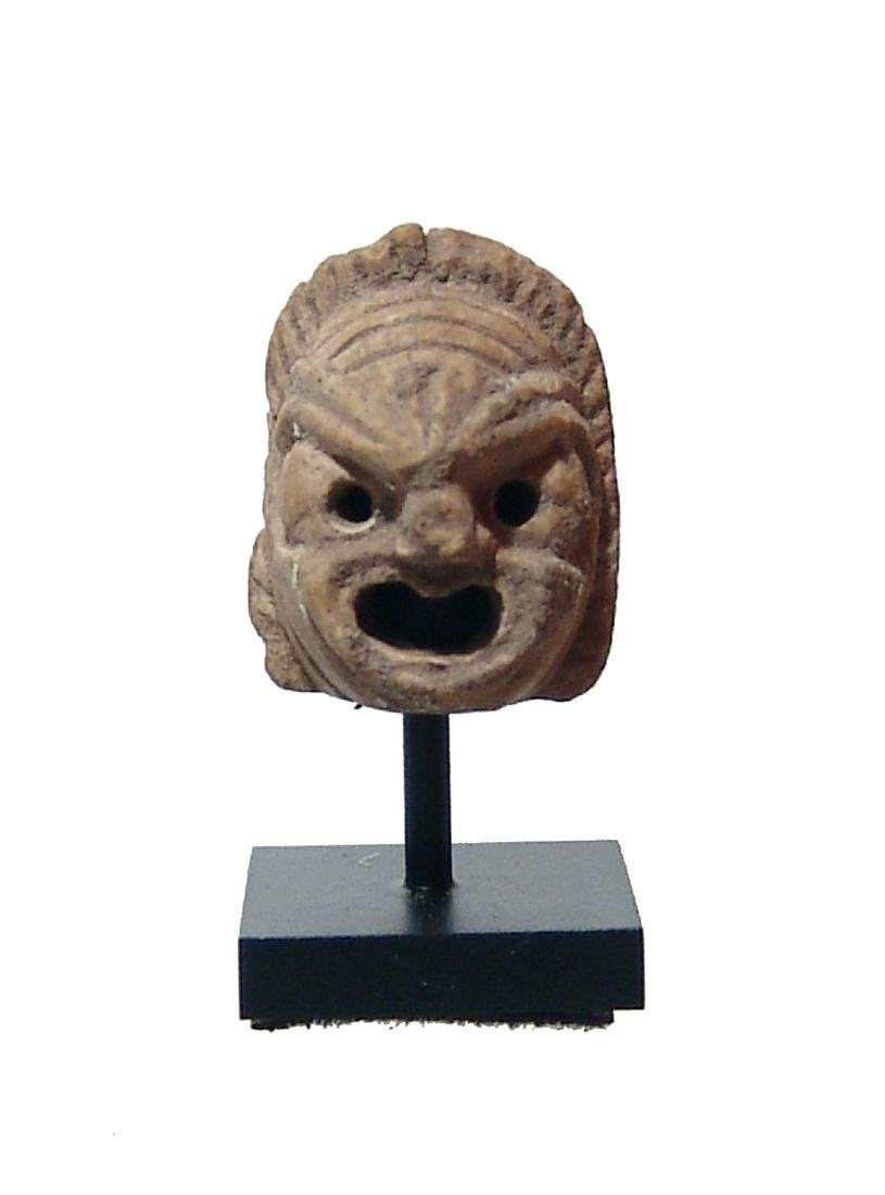 Roman ceramic amulet in the form of an actor's mask