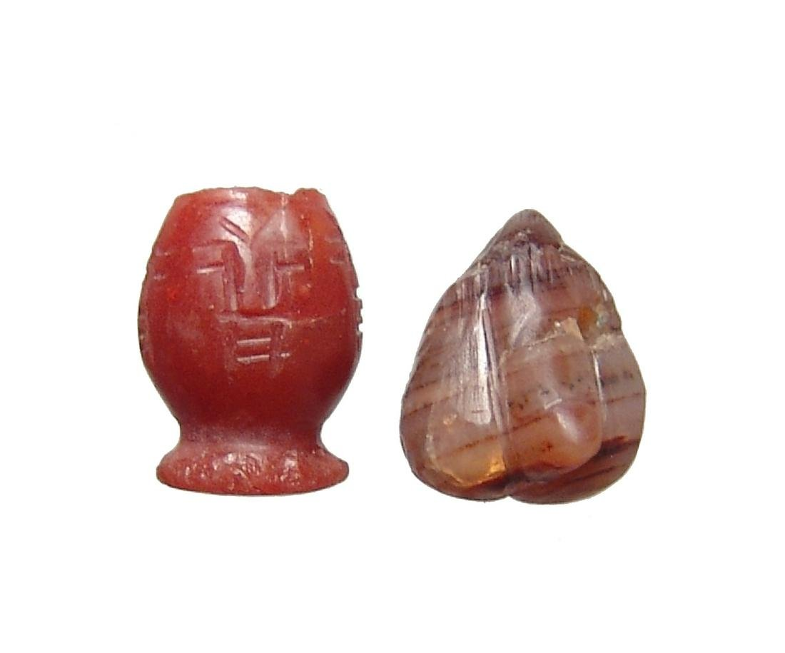 A pair of ancient stone amulets