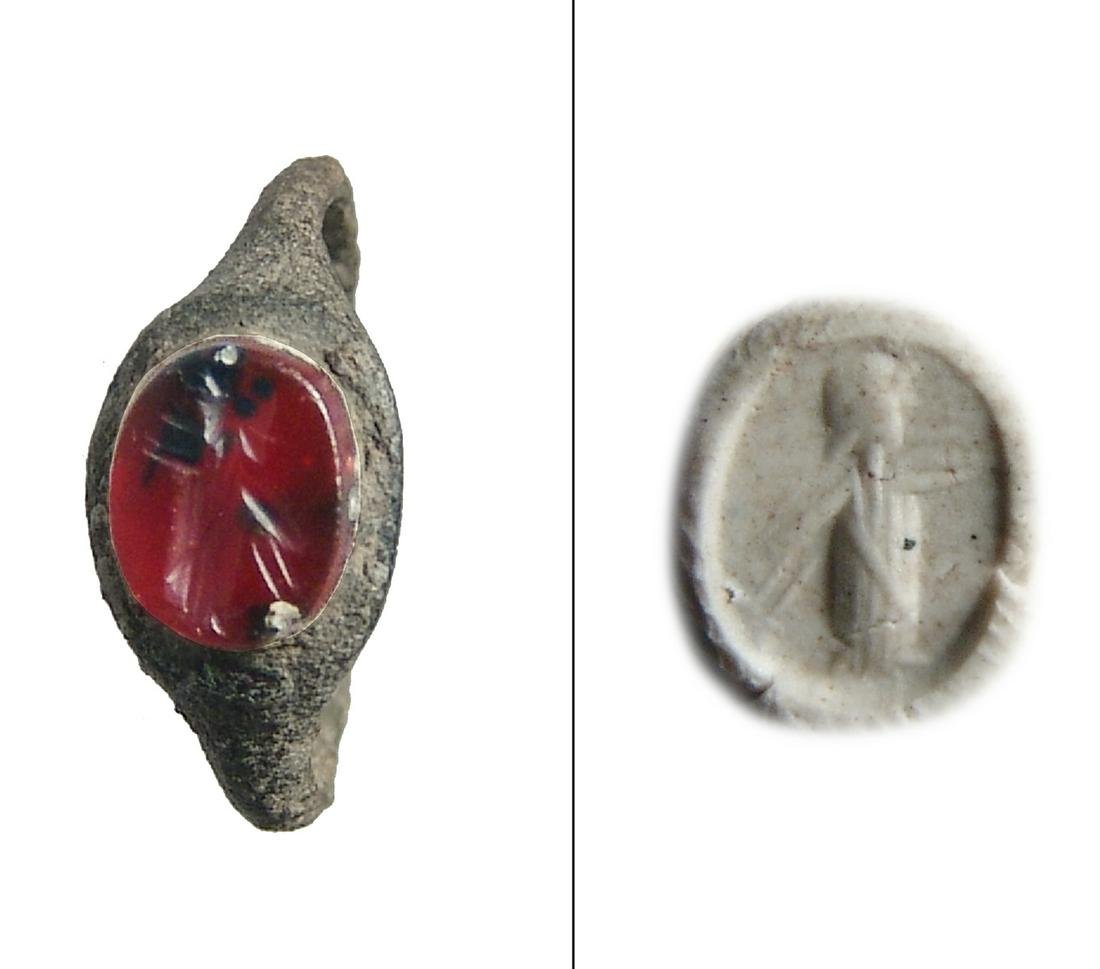 A Roman bronze ring with carnelian ring stone