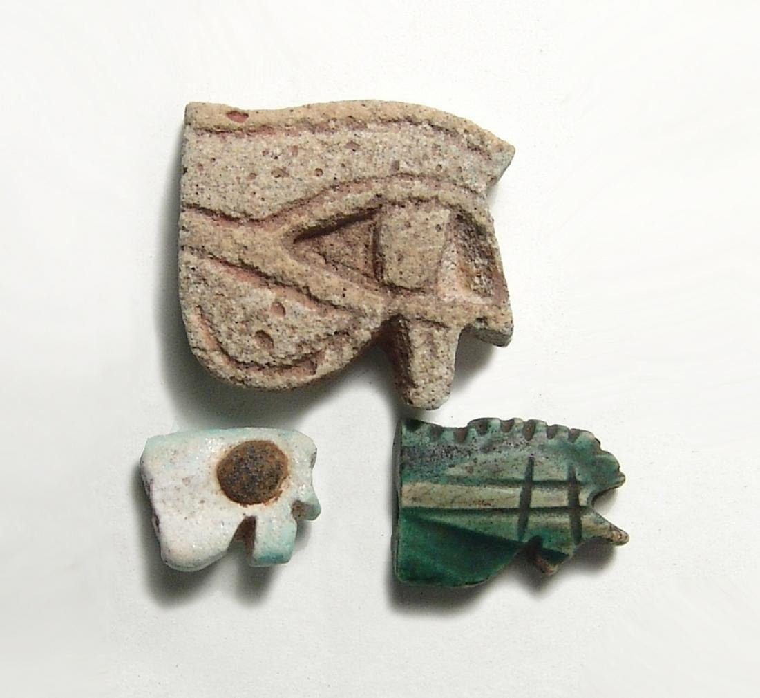 A group of 3 Egyptian 'Eye of Horus' amulets